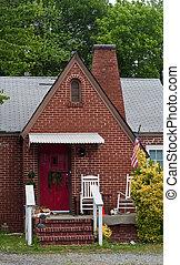 Old Brick Cottage with Red Door