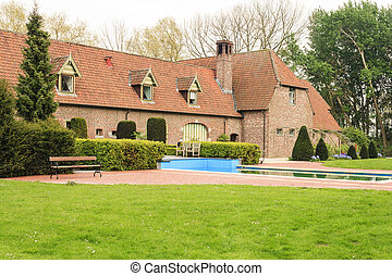 Old brick farm house with swimming pool