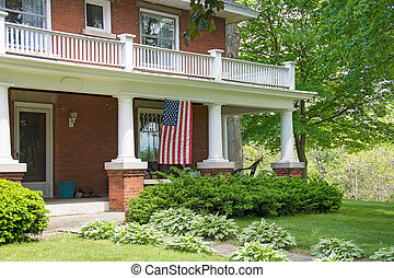 old brick home with American flag