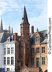 old brick house on the channel in Bruges in a sunny day. Belgium