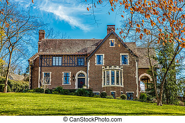 Old Brick House with Classic Windows on Green Grass