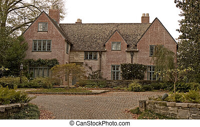 Old Brick Mansion - An old brick mansion and driveway on an...