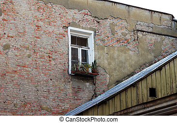 Old brick wall and single window