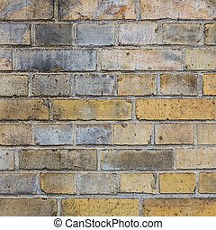 brick wall background in yellow colors