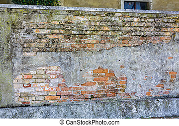 Old Brick Wall Covered with Mortar