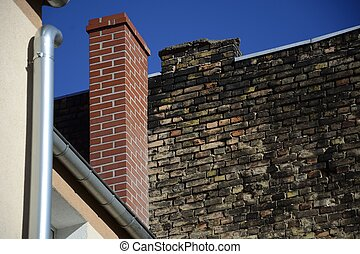 Old brick wall on a background of blue sky