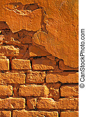 old brick wall painted in orange color