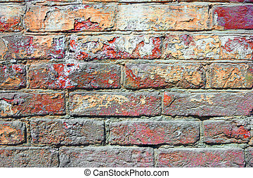 Old brick wall painted in red color