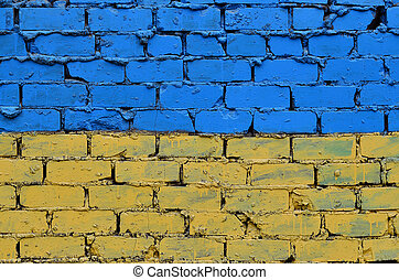 Old brick wall painted in the colors of the Ukrainian flag