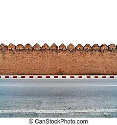 old brick wall with concrete sidewalk