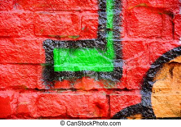 Old brick wall with graffiti