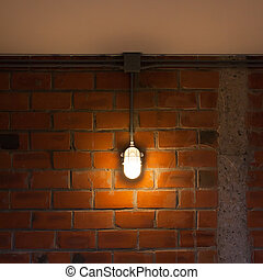 Old brick wall with industrial light