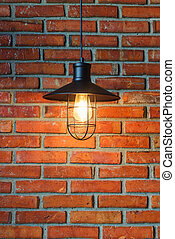 Old brick wall with lamp