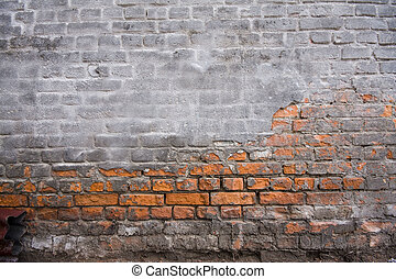 Old brick wall with plastered parts as a background