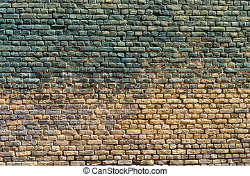Old brick wall with traces of paint