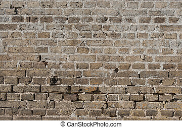 Old brick wall with worn stones