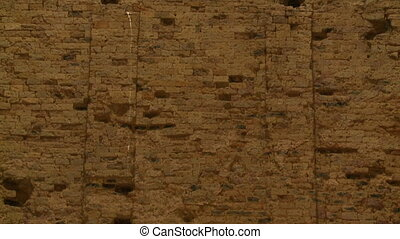 A closeup shot with upward tilting view of the tall brick walls of the Khmer ruins of Sambor Prei Kuk located in the north of the city of Kampong Thom of Cambodia. .