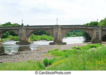 old bridge and river Tyne at Corbridge, Northumberland -...