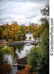 Old bridge in autumn park. Beautiful fall scene.