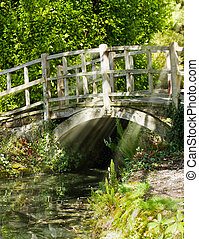Old bridge in summer sunlight