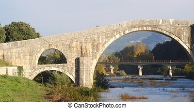 Old bridge in Trebinje, architecture travel background - Old...