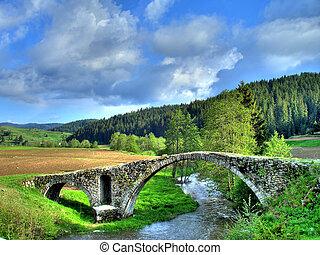 Old Romam bridge in the mountain Rhodopi
