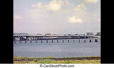 Old bridges on Lagos lagoon to Lagos island. Historical archival of Lagos city of Nigeria state of Africa in 1970s.