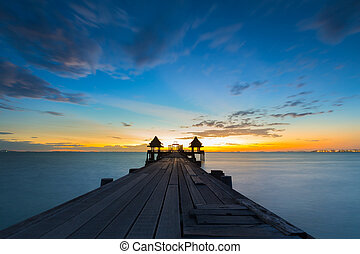 Old bridge on sea in sunset