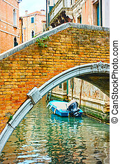 Old bridge over canal in Venice,