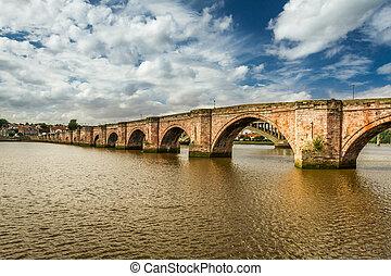 Old bridge over river Tweed in summer