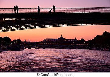 Old bridge silhouette over the river