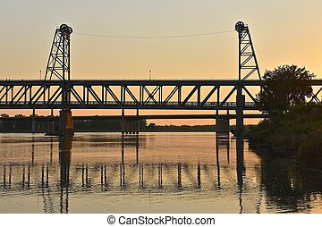 Old bridge silhouetted in the sunset