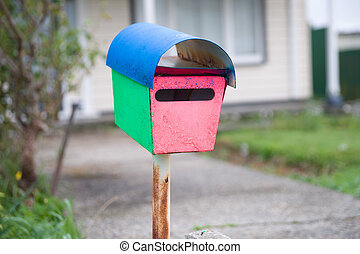 Old brightly pained letterbox. - Old brightly painted...