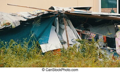 Old broken awning for poor people. Poor people live in dirty...
