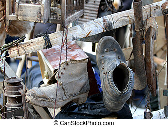old broken boots, knickknacks and generic stuffiness in old iron bench
