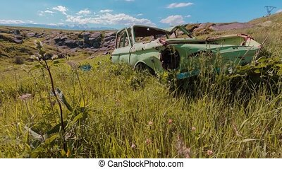 Old broken car in the Armenian valley timelapse video