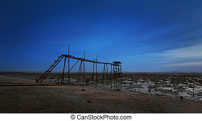 old broken jetty during blue hour