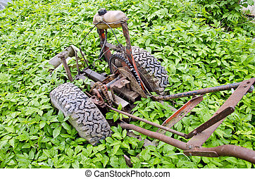 old broken motor plough in farm spring garden