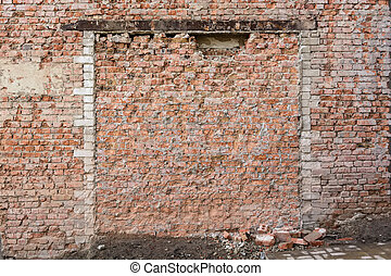Old broken red brick wall
