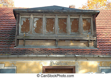 Old broken windows in ruined house