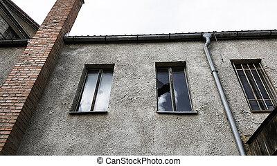 Old broken windows on an abandoned old building. Vintage tone
