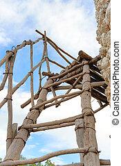 Old broken wooden ladder