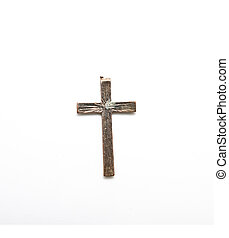 old bronze cross on a white background