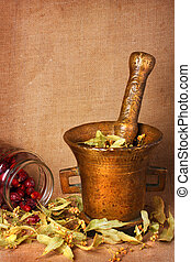 Old bronze mortar with herbs and rose hips - Old bronze...