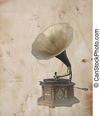 Old bronze Phonograph over vintage old paper background