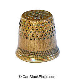 Old bronze sewing thimble isolated on white background.