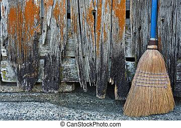 old broom by barn