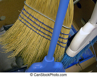 Old brooms in box - Collection of old worn brooms sitting in...
