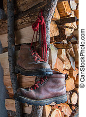 old brown boots on woodpile background