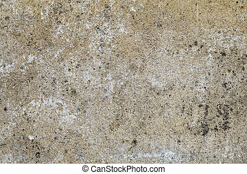 Old brown stone wall with mold